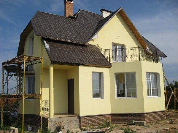 Оштукатуренные кирпичные дома